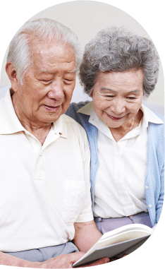 elderly couple reading book