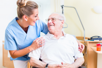 senior man and his caregiver in a nursing home