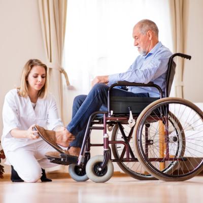 nurse and a senior men in a wheelchair