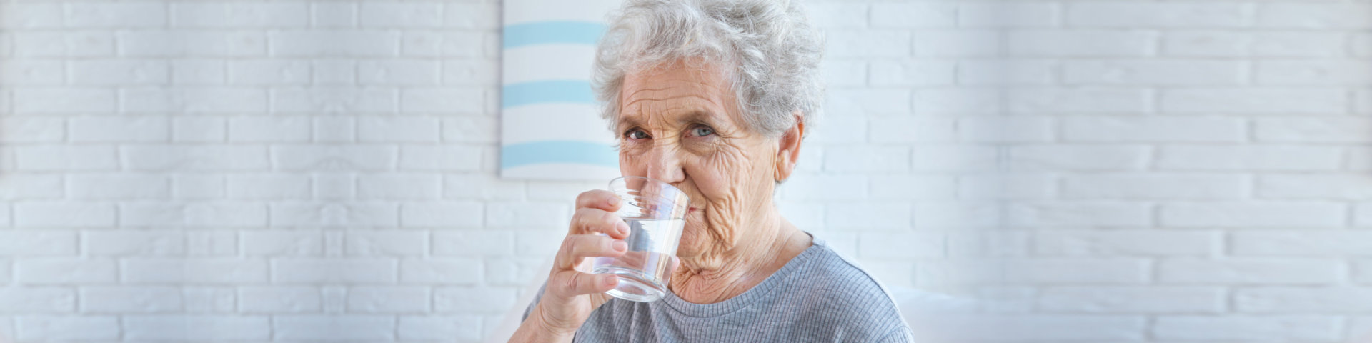 Senior woman drinking a glass of water